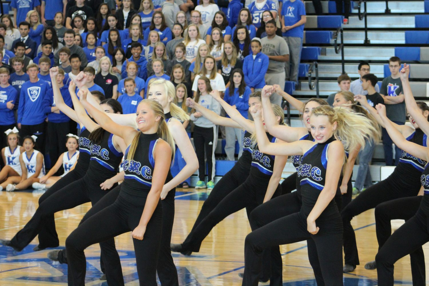 During the Homecoming Pep Rally, seniors Sabina Kelly and Lexi O'Malley lead the pom pon squad routine Oct 2. Photo by Nikki Bulger, staff photographer
