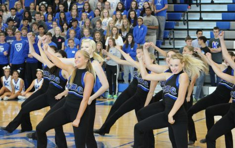 Pom squad 'kicks it' at halftime performance