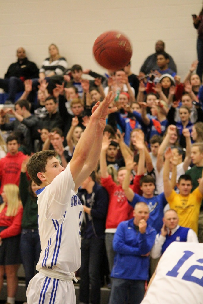 After being fouled, junior Christopher Meitzner shoots a free throw during the third quarter of the basketball against South at Kapaun Jan. 8. Kapaun lost 54-69. Photo by Uyen Tran