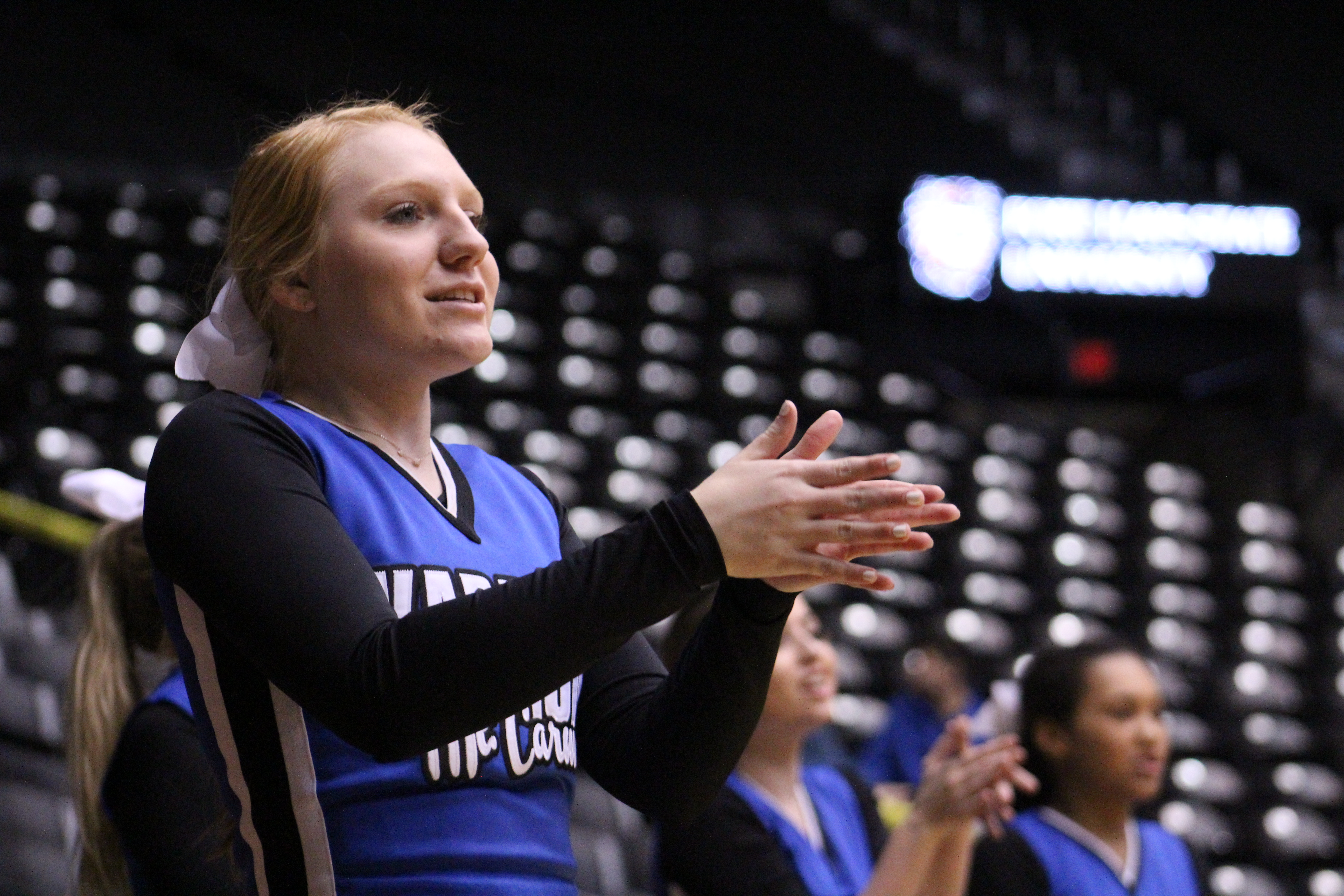 During the boys varsity basketball game, sophomore Natalie Dreher cheers after the Crusaders scored a point against Goddard Jan. 14. The boys where participating in the WATC challenge, which featured cross-conference matchups from the GWAL and the AVCTL leagues. Photo by Jillian Schmitz