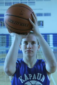 Focusing on the rim, junior Cori Hough lines up her shot. Holly Harpel, Sports 1 Editor