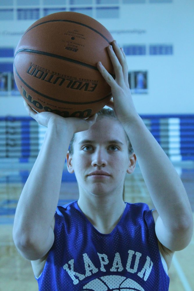 Focusing+on+the+rim%2C+junior+Cori+Hough+lines+up+her+shot.+Holly+Harpel%2C+Sports+1+Editor