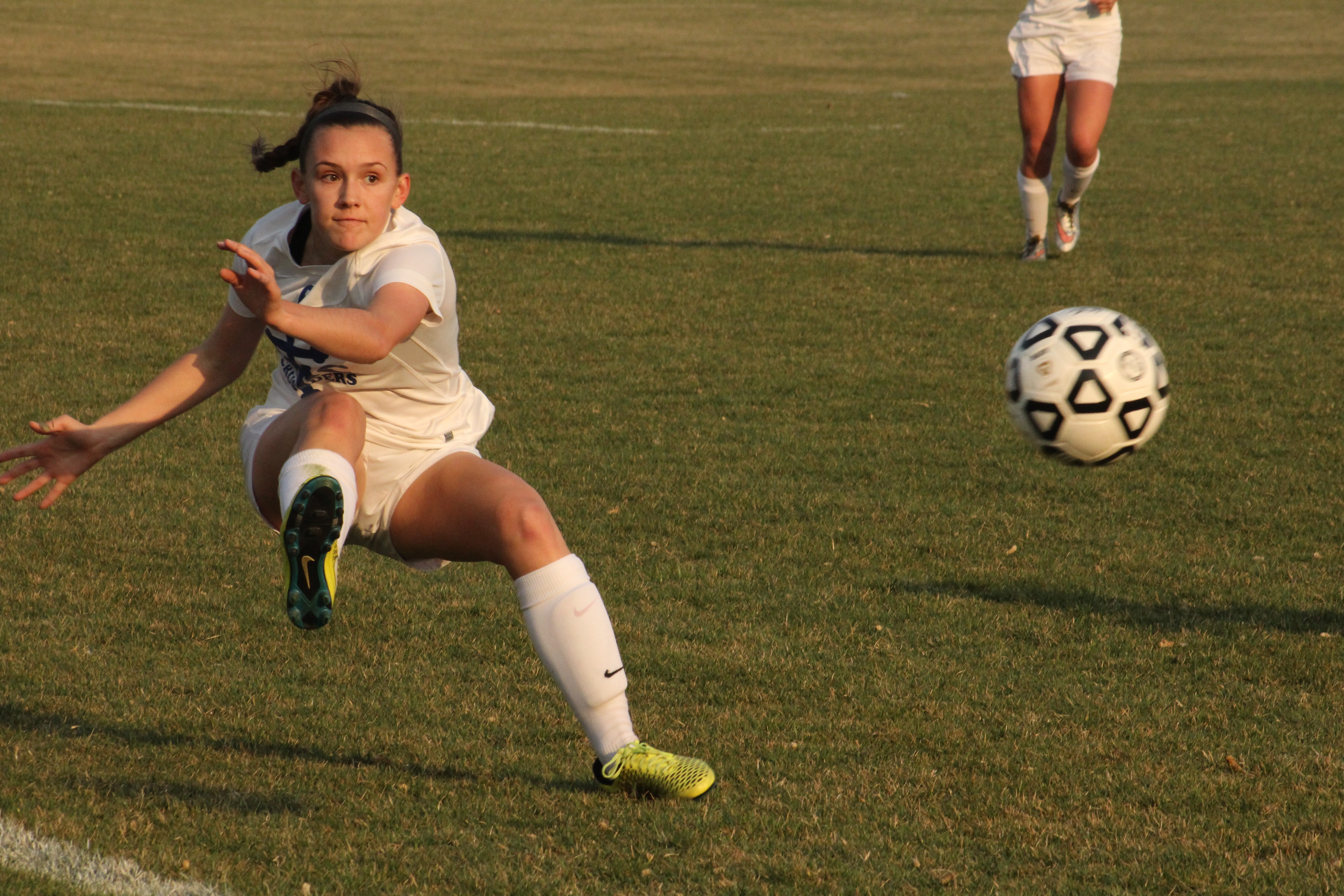 Kaley Ball kicks the ball before it goes out of bounds to a teamate during her soccer game at the Stryker complex on March 23 Anna Craig, Staff photographer