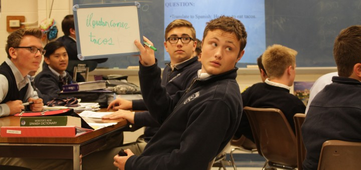 Showing his answer to the teacher, junior Jonah Nichols raises up his whiteboard while playing jeopardy March 14.