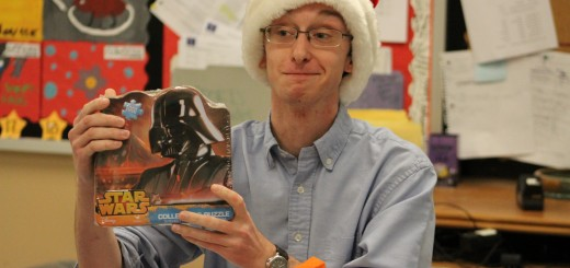 Peter Ercolani, the writer behind Pete's Perspective, opens a Star Wars puzzle he received during Paladin's Secret Santa gift exchange. Ercolani was the Entertainment/Opinion editor for two years. Photo by Elaine Robinson