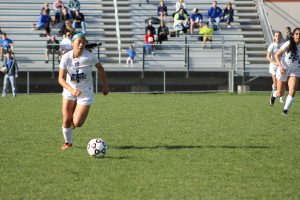 Looking for a teammate to pass a through ball to, sophomore Evelyn Nguyen runs to the right side of the field.