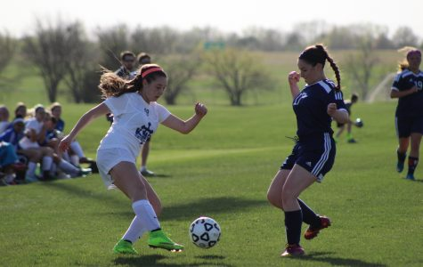 KMC upsets Carroll; contends for City League title