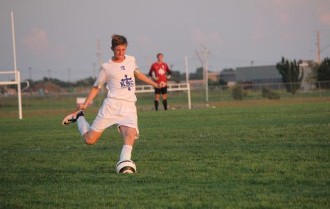 Junior Brendan Dehner, getting ready to kick the ball cross the field at Stryker on Sept. 15. Photo by Sarah Nguyen