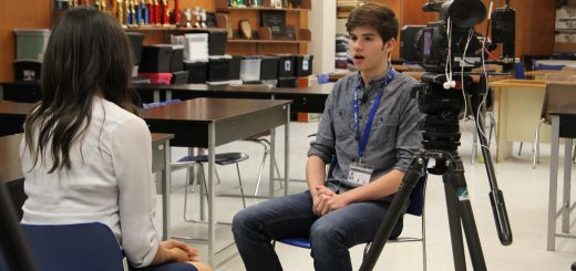 Senior Gabe Esquivel is being interviewed about his work implementing debate in Costa Rica. Eddie Flores, photographer