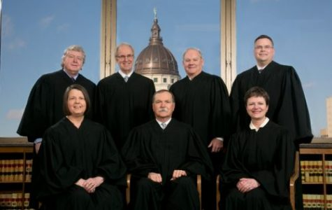 Kansas justices beat ouster campaign
