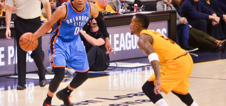 Russell Westbrook (0) drives by Jr Smith (5)