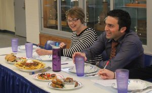 During the Foods II cook-off April 20, business teacher Pam Stipanuk and English teacher Nate Arida grade the presentation of the four groups' food before eating. Available teachers acted as judges during the different Foods class blocks.