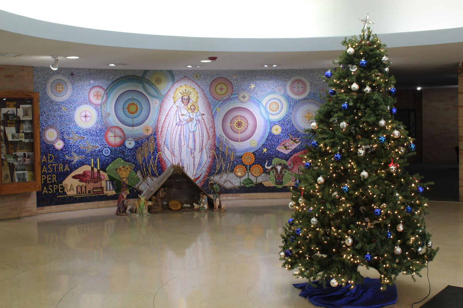 As a symbol of the modern-day Christmas season, a Christmas tree stands in the center of the KMC Round for the holidays. Christmas trees date back to ancient Egypt. photo by Isaac Caire