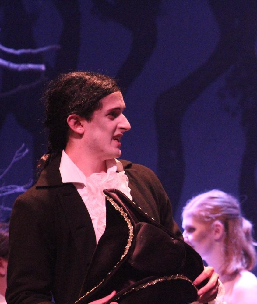 Reciting his lines, senior Gary Woodburn executes his role as  Ichabod for the
