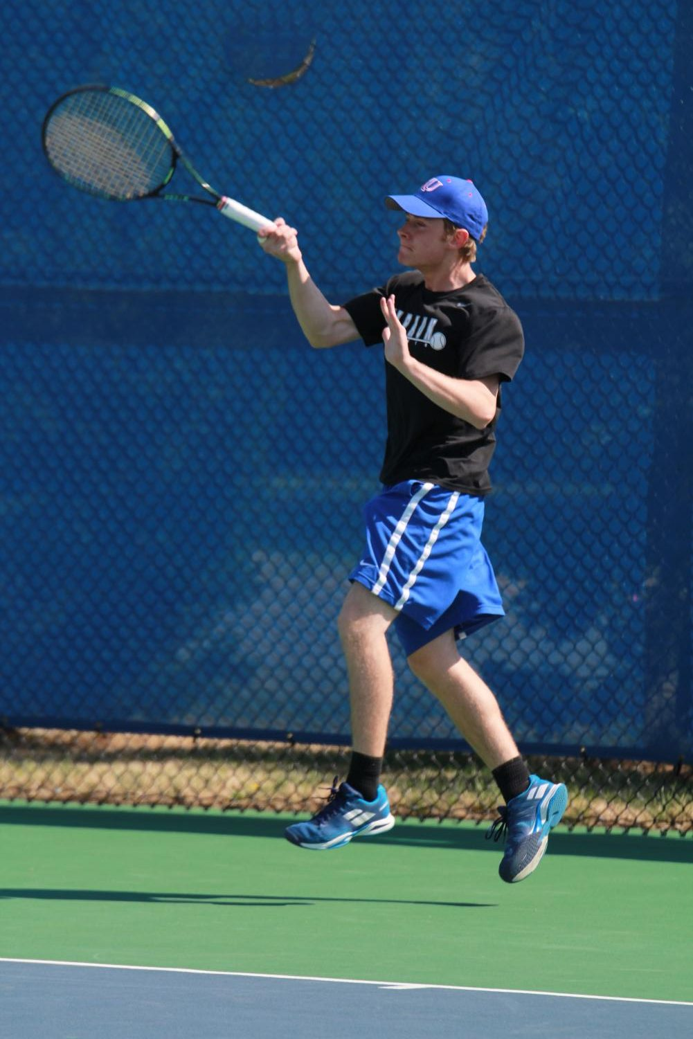 Senior Andrew Klimiuk returns his opponents serve at the Collegiate Invitational March 28 in #1 singles. Klimiuk advanced to the championship match, but lost 8-4. photo by John Biehler