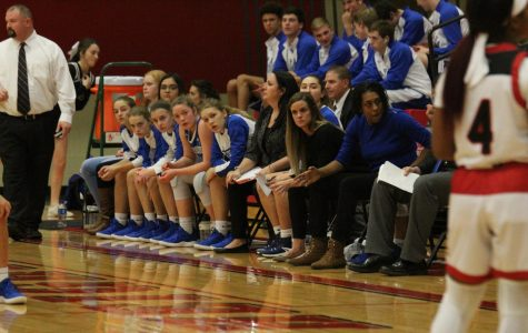 Anticipating a play, Lauren Rudy, Evan Dalian, Maggie Gann, Mason Bina, Emma Bezdek watch their team. The girls varsity team lost to Heights 33-68 on Dec. 4.