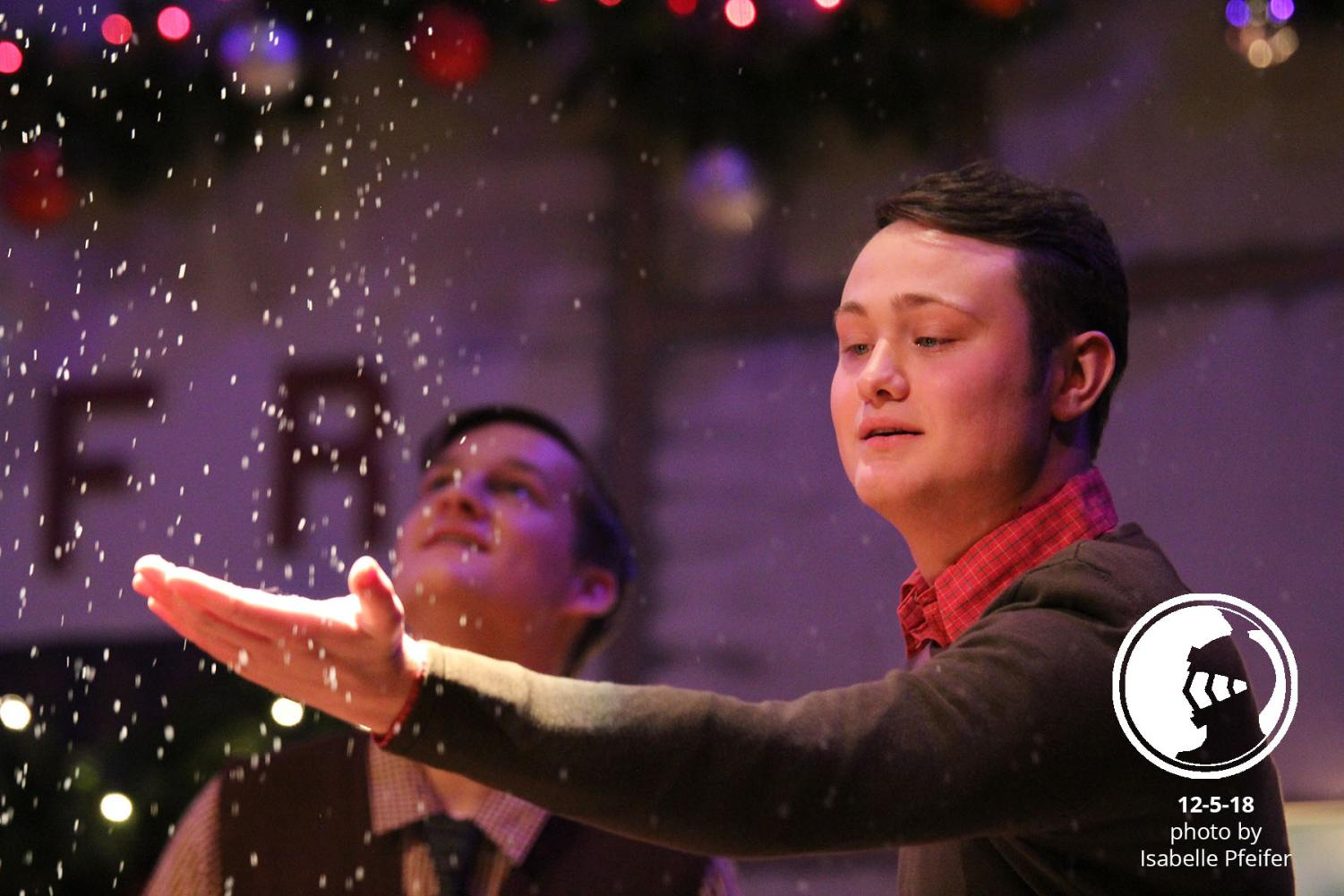 In the closing scene, senior Jonah Nichols reaches for the snow Dec 5. The play ran Dec. 6 and is scheduled for Dec. 8 and Dec. 9.