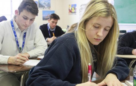 Practicing their Spanish grammar, Sophomores Hadleigh Drake, Stephan Buchanan, and Alex Perez take notes in class.