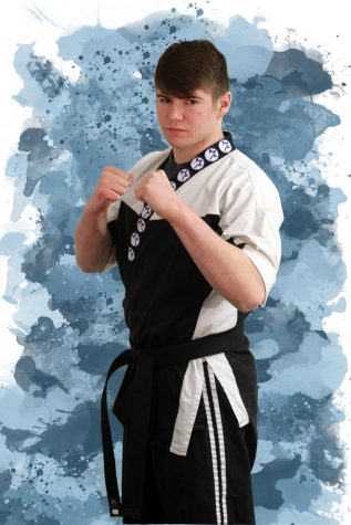 In his karate gi, sophomore Doug Bates demonstrates the fighting stance. Bates was offered a job at the age of 16 as a sensei at Activstars. Photo by John Biehler