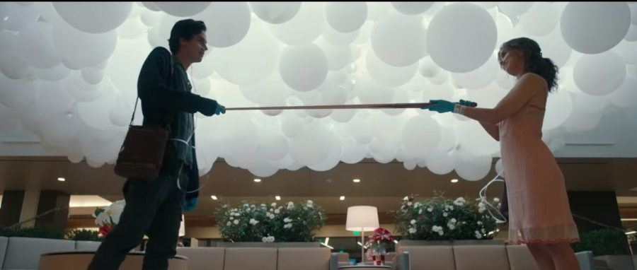 "To measure the distance, Will, played by Cole Sprouse, and Stella, played by Hayley Lu Richardson, hold a pool stick between them on their first official date. ""Five Feet Apart"" was released March 15. image courtesy of CBS"