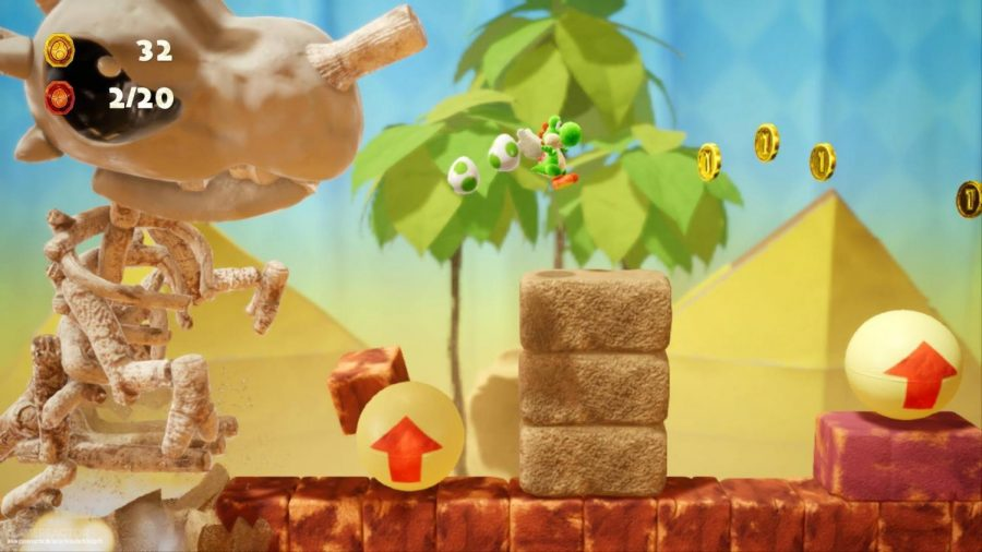 Jumping over rocks, Yoshi attempts to run away from Skelesaurus. The level is called Skelesaurus Wrecks, and it's your job to run away from the angered skeleton dinosaur. Photo from screenshot of gameplay.