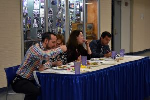 Kapaun Mt. Carmel teachers James Lewis, Jennifer Leeker, Barbara Kral and Brian Carillo eat and judge the food that students in the Foods II class prepared for a class competition April 20.