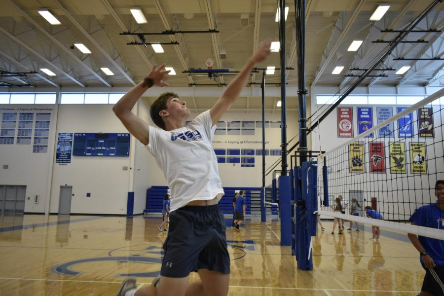 Jumping up to attack the ball, senior Ryan McCully prepares to spike in a volleyball game. McCully represented the St. Clare of Assisi House in the House Olympics Aug. 18.