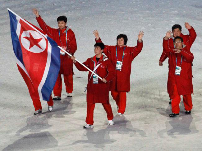 At the 2014 Olympics, North Korean athletes and coaches wave during the opening ceremonies in Sochi. The Korean athletes have combined to form a unified team to participate in this year's Olympics in Pyeongchang, South Korea. photo courtesy of Wikimedia Commons