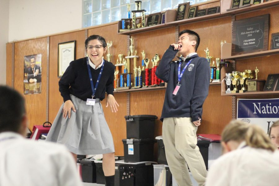 Performing a duo, junior Sophie Miller and sophomore Timothy Do recite a piece in unison and elicit a laugh from their classmates April 24.