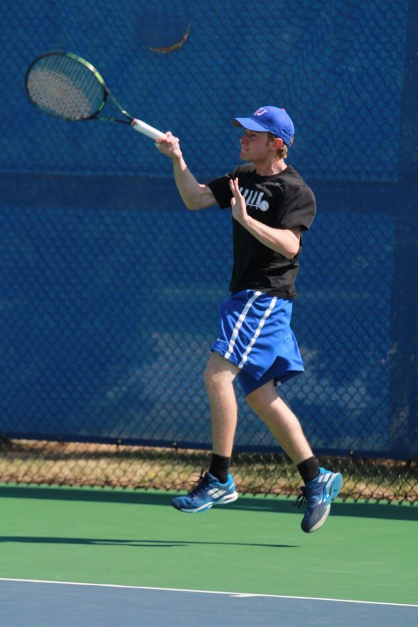 Senior+Andrew+Klimiuk+returns+his+opponents+serve+at+the+Collegiate+Invitational+March+28+in+%231+singles.+Klimiuk+advanced+to+the+championship+match%2C+but+lost+8-4.+photo+by+John+Biehler