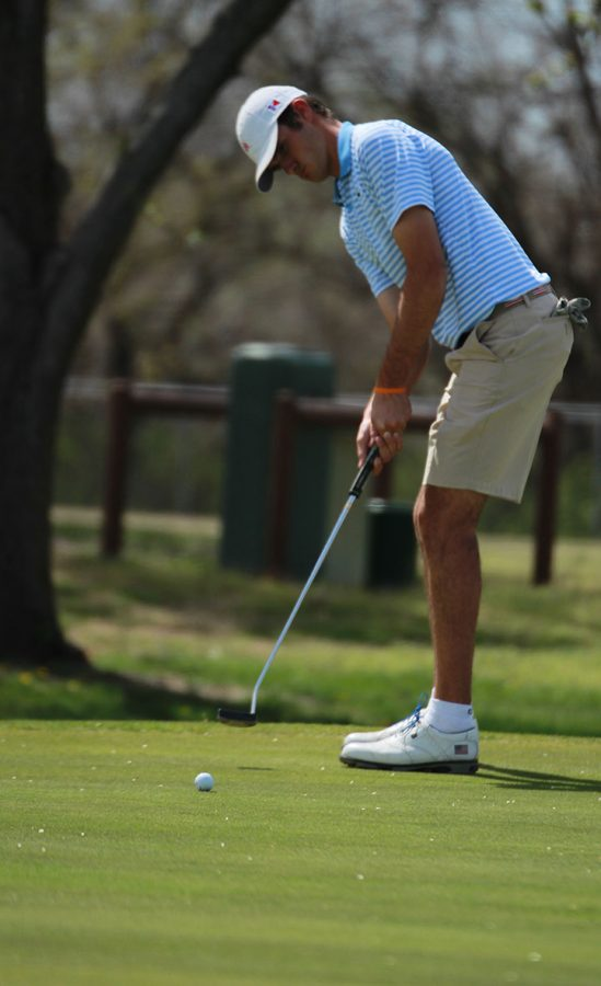 Watching the ball roll, junior Jack Baker putts April 17 at Sim Park Golf Course. Baker finished first individually in the GWAL tournament with a 73, and the Crusaders finished first as a team.