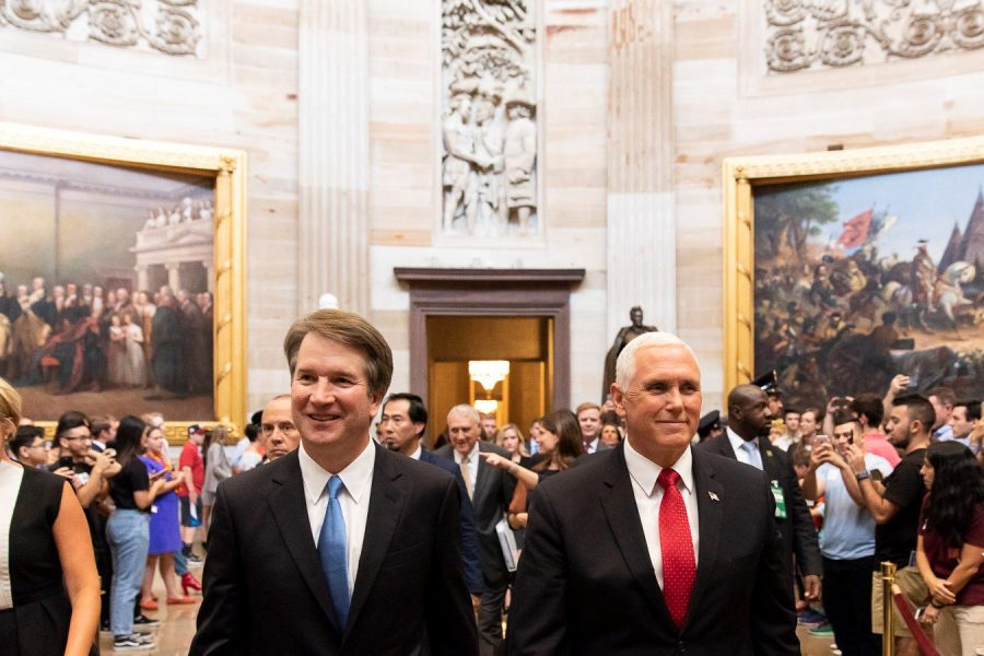 Walking in the Capitol building, Vice President Mike Pence escorts Judge Brett Kavanaugh to his confirmation hearings July 10. The hearings were marked by accusations from Democrats and fervent support from Republicans. photo courtesy of Wikimedia Commons