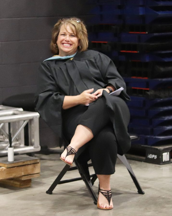 Waiting for graduation to start, former Dean of Academics Kelly Dandurand sits at Hartman Arena in preparation for the May 2018 graduation. Dandurand left KMC Aug. 3 and KMC is beginning to find a replacement for the upcoming school year. photo by John Biehler