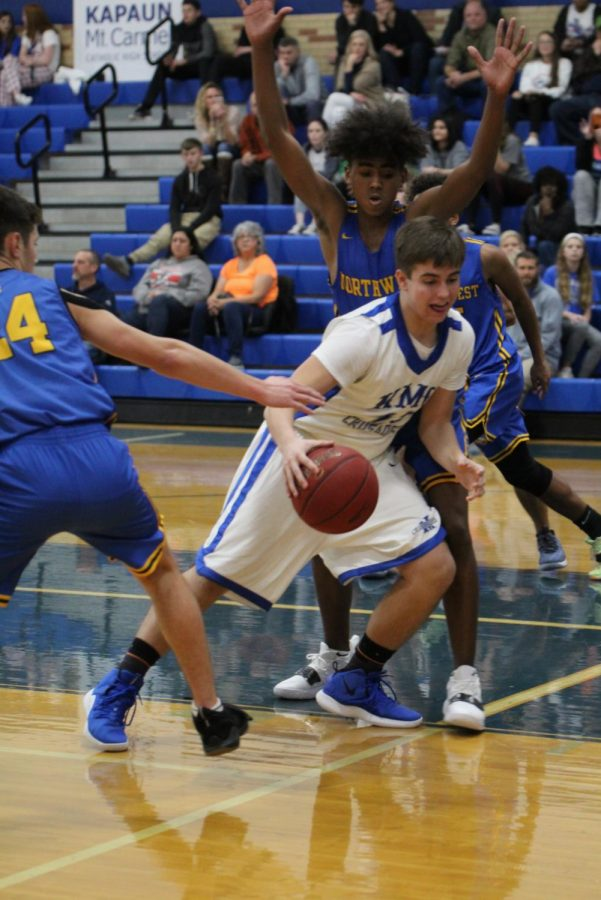 Dribbling to the basket, sophomore Joe Ackerman attempts to drive the ball to the basket against the Northwest, Nov. 30. The J.V. team lost against the Grizzlies.