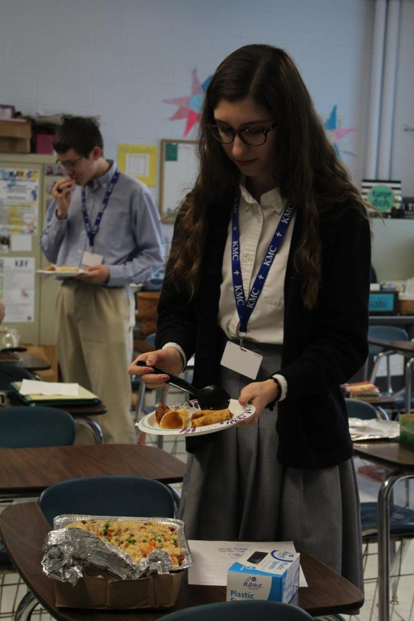 Adding food to her plate, junior Maycie Saunders gets fried rice on
