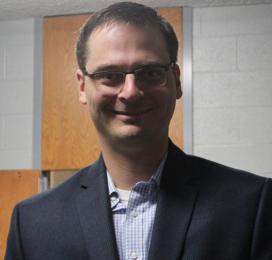 In the faculty lounge, future Dean of Academics David Stephenson poses for a photo after meeting the faculty and teachers at Kapaun Mt. Carmel and touring the building Jan. 18. He will start the role July 1.
