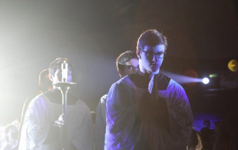 Seniors Will Woodburn, Tanner Weins and Michael Hogan lead the Eucharistic procession among the student body March 26 in the old gym. Photo by John Biehler