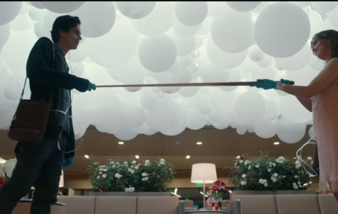 """To measure the distance, Will, played by Cole Sprouse, and Stella, played by Hayley Lu Richardson, hold a pool stick between them on their first official date. """"Five Feet Apart"""" was released March 15. image courtesy of CBS"""