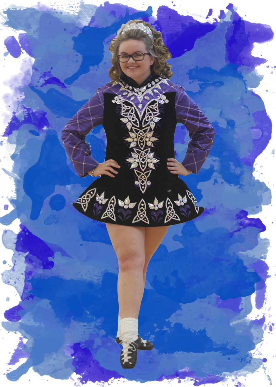 Pointing her toe, senior Kylie Bitcon poses in her dance costume. Bitcon participates in Irish dancing.