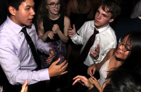 Dance to this, Joshua Bui, Julia Gonzalez, Ryan Cosgrove, and Katie Ha socialize at their homecoming dance last year at KMC, free of social distancing. photo by Helen Tran