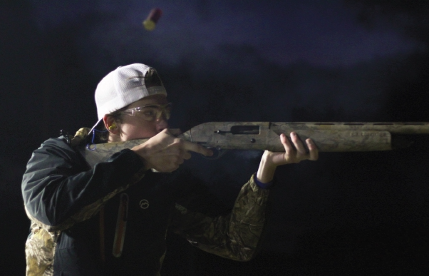 IT'S A TRAP! A shell flies out as senior Isaac Stephens shoots his 12 gauge shot gun at a trap shooting competition at Ark Valley Shooting Range Oct. 22. Stephens attempted to break the school record of hitting 50 targets. He had hit 49 consecutively earlier this season. photo by JD Biehler