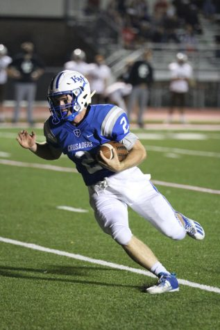 Called back. Late in the second quarter, senior quarter, Andrew Gimino rushes for what would have been a 15 yard touchdown against Garden City at Adair-Austin Stadium Oct. 9. A holding penalty would negate the score and the drive would stall out. The Crusaders would go on to win 56-0