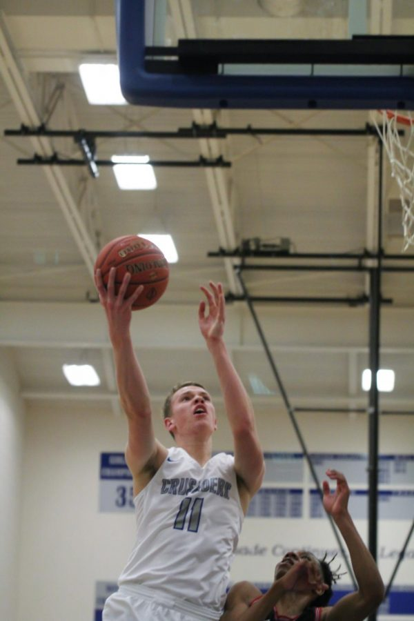KMC played Wichita Heights on Jan 26. at KMC. Henry Thengvall takes the ball up for a lay up. The boys won this game 56-46.