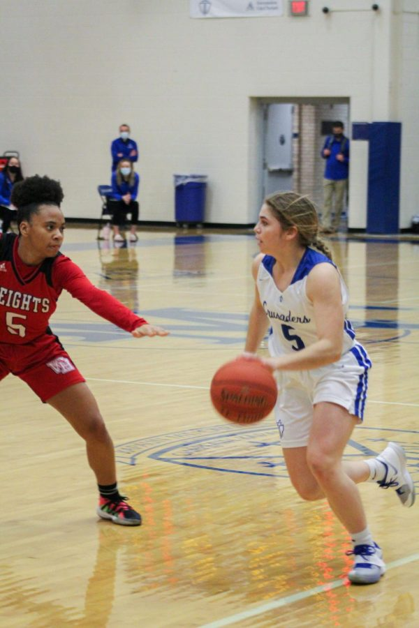 KMC girls basketball team works overtime to beat heights high school.
