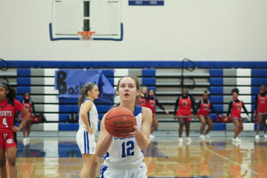 KMC girls basketball team puts all their effort and focus into beating and defeating  heights high school.